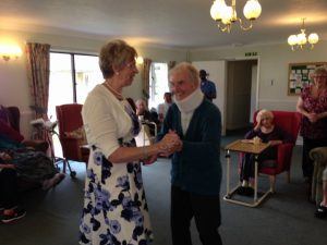 Resident Ernie has a dance with singer Muriel